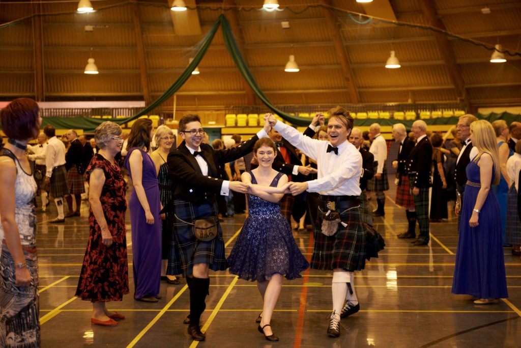 Scottish country dancers at a ball